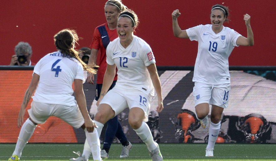 England's Lucy Bronze, centre, celebrates with teammate Fara Williams, left, as Jodie Taylor cheers on in the background in the second half of soccer action during the Round of 16 at the FIFA Women's World Cup Monday June 22, 2015 in Ottawa, Ontario, Canada. (Adrian Wyld/The Canadian Press via AP) MANDATORY CREDIT