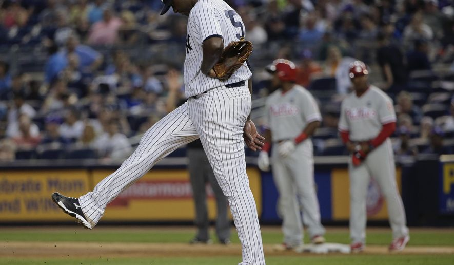 New York Yankees pitcher Michael Pineda reacts after giving up a two-run single to Philadelphia Phillies' Maikel Franco during the fourth inning of a baseball game Monday, June 22, 2015, in New York. (AP Photo/Julie Jacobson)