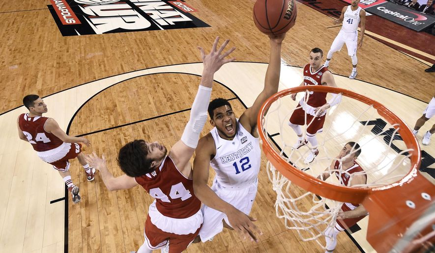 FILE - In this April 4, 2015, file photo, Kentucky's Karl-Anthony Towns (12) drives to the basket past Wisconsin's Frank Kaminsky (44) during the first half of the NCAA Final Four national semifinal college basketball game in Indianapolis. Small ball was the story of the NBA Finals. It might seem temporarily forgotten at the start of the NBA draft. The first three players taken Thursday, June 25, 2015, could easily be a trio of big guys, led by Kentucky's Karl-Anthony Towns.   (Chris Steppig/NCAA Photos via AP, Pool, File)