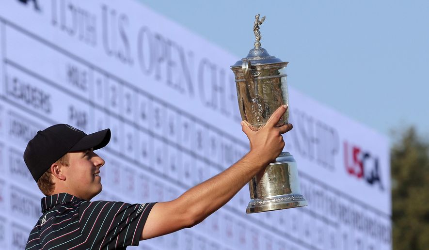 FILE - In this Sunday, June 21, 2015, file photo, Jordan Spieth poses with the trophy after winning the U.S. Open golf tournament at Chambers Bay in University Place, Wash. Spieth loves golf history, which is appropriate for someone quickly becoming part of it. He is halfway home to the Grand Slam.  (AP Photo/Charlie Riedel, File)