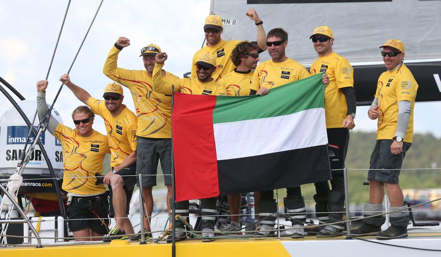 Overall winner Abu Dhabi Ocean Racing team skippered by Britain's Ian Walker, 3rd left, celebrate after crossing the finish line of the 9th leg of the Volvo Ocean Race from French Lorient to Gothenburg, in Gothenburg, Sweden, on Monday June 22, 2015. (Bjorn Larsson Rosvall/TT via AP) SWEDEN OUT