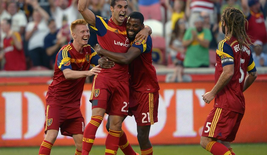 Real Salt Lake forward Sebastian Jaime (23) celebrates his goal with teammates Justen Glad (14), Aaron Maund (21) and Kyle Beckerman (5) in a U.S. Open Cup soccer match against Sporting KC, Sunday, June 21, 2015, in Sandy, Utah. (Leah Hogsten /The Salt Lake Tribune via AP) DESERET NEWS OUT; LOCAL TELEVISION OUT; MAGS OUT