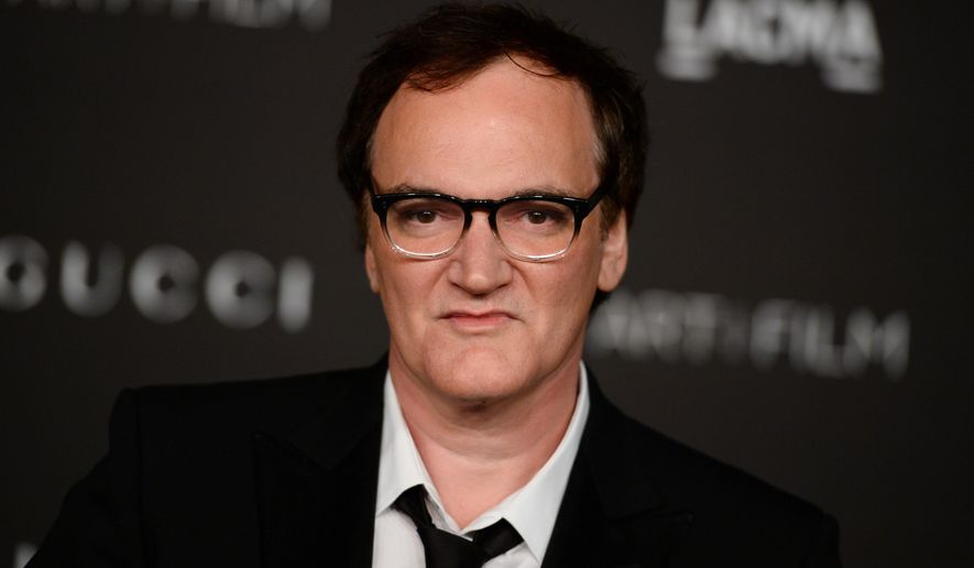 FILE - In this Nov. 1, 2014 file photo, honoree Quentin Tarantino arrives at the LACMA Art + Film Gala at LACMA in Los Angeles. Tarantino, Tracy Morgan, Steve Carell, LL Cool J, Kathy Bates, Bruno Mars and Cyndi Lauper are among the famous names set to be added to the Hollywood Walk of Fame next year. The Hollywood Chamber of Commerce announced its selections for 2016 on Monday, June 22, 2015. (Photo by Jordan Strauss/Invision/AP, File)