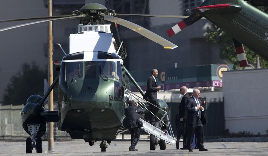President Barack Obama steps from Marine One in Pasadena, Calif., Friday, June 19, 2015, en route to tape a podcast interview with comedian Marc Maron. (AP Photo/Carolyn Kaster)