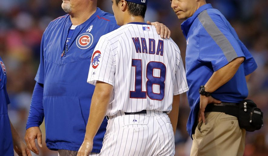 Chicago Cubs pitching coach Chris Bosio, left, places his hand on the shoulder of starting pitcher Tsuyoshi Wada shortly before Wada left the game during the third inning of a baseball game against the Los Angeles Dodgers Monday, June 22, 2015, in Chicago. Also checking on Wada is trainer PJ Mainvile, right. (AP Photo/Charles Rex Arbogast)