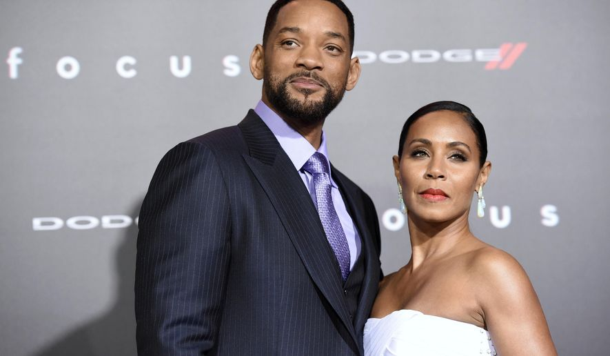 "FILE - In this Feb. 24, 2015 file photo, Will Smith, left, and Jada Pinkett Smith arrive at the world premiere of ""Focus"" at the TCL Chinese Theatre in Los Angeles. Los Angeles prosecutors say a Virginia woman trespassed at the home of actor Smith and refused to leave. Ariel Archer was scheduled to be arraigned Monday, June 22, 2015, in Los Angeles Superior Court in Van Nuys.  (Photo by Chris Pizzello/Invision/AP, File)"