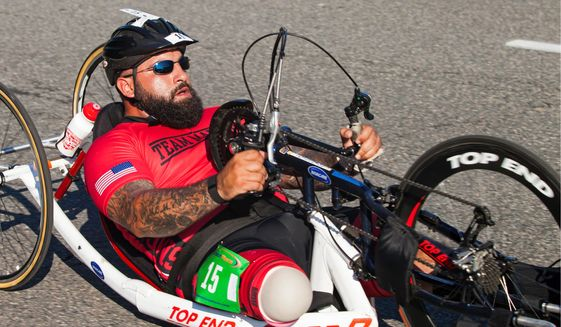 A member of the Marines team participates in the Paralympic-style cycling event at the 2015 DOD Warrior Games at the Marine Corps Base in Quantico, Virginia, Sunday. The Games offer eight adaptive sports. (U.S. Marine Corps)