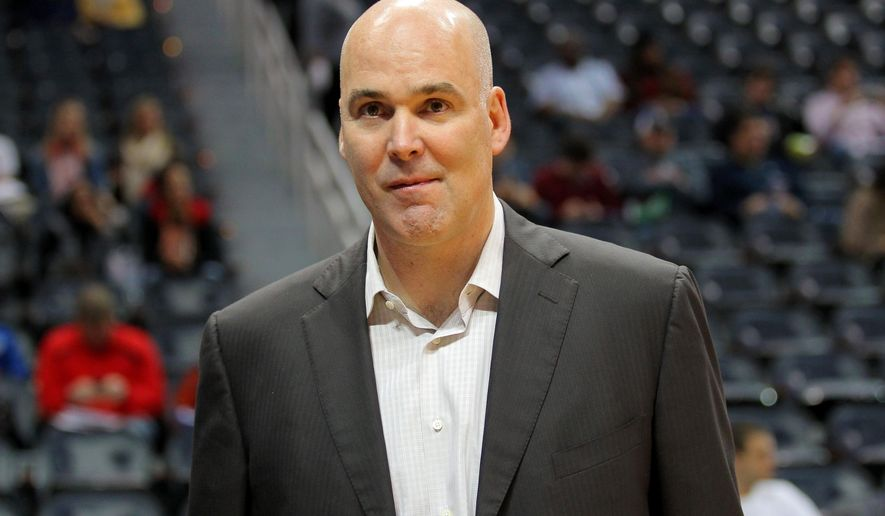 FILE - In this Dec. 15, 2012, file photo, Atlanta Hawks General Manager Danny Ferry watches before an NBA basketball game against the Golden State Warriors in Atlanta.  The Hawks have announced Monday, June 22, 2015, that Ferry has stepped down as general manager of the team, ending an indefinite leave of absence that began in August following racially derogatory comments Ferry made. (AP Photo/Todd Kirkland, File)