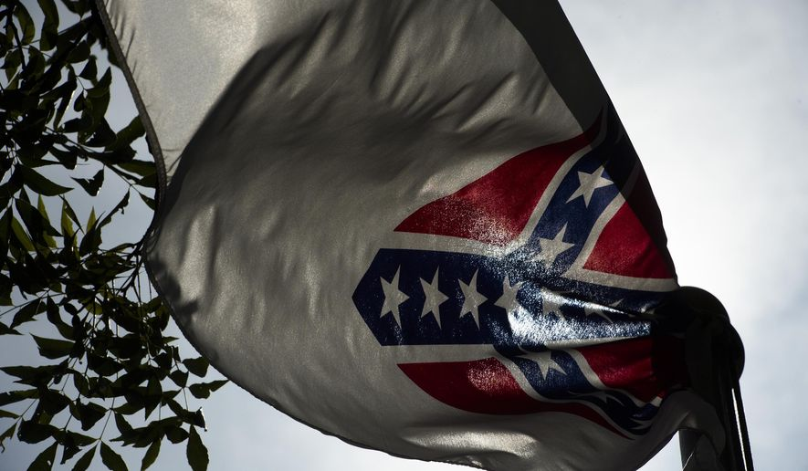 A Confederate flag flies next to the Alabama Confederate Memorial on the grounds of the Alabama Capitol building in Montgomery, Ala., Monday, June 22, 2015. (Albert Cesare/The Montgomery Advertiser via AP)  NO SALES; MANDATORY CREDIT