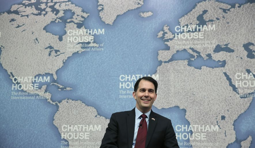 FILE - This Feb. 11, 2015 file photo shows Wisconsin Gov. Scotrt Walker before his speech at Chatham House in central London, England. Walker, a potential Republican presidential candidate, and governors across the country have been packing their bags for all-expenses-paid trade missions abroad, spending taxpayer dollars on costly trips that have an uneven track record of yielding any tangible benefits for their states. Walker went to London in February, a trip that alone cost the state more than $138,000, and took a trip to Germany, Spain and France in April _ all touted as ways to attract foreign investment to Wisconsin. (AP Photo/Lefteris Pitarakis, File)