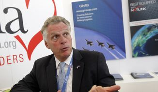 In this photo taken Tuesday June 16, 2015, Virginia Gov. Terry McAuliffe speaks during an interview with the Associated Press during the Paris Air Show, at Le Bourget airport, north of Paris. (AP Photo/Christophe Ena)