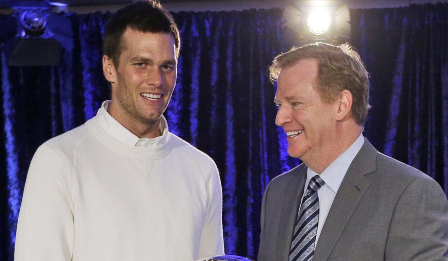 FILE - In this Feb. 2, 2015, file photo, New England Patriots quarterback Tom Brady poses with NFL Commissioner Rodger Goodell during a news conference after NFL football's Super Bowl XLIX in Phoenix, Ariz. Brady's appeal hearing is Tuesday, June 23, 2015, in New York, and one of his main arguments in contesting the four-game ban for using underinflated footballs in the AFC title game is Goodell's role in the matter.  (AP Photo/David J. Phillip, File)