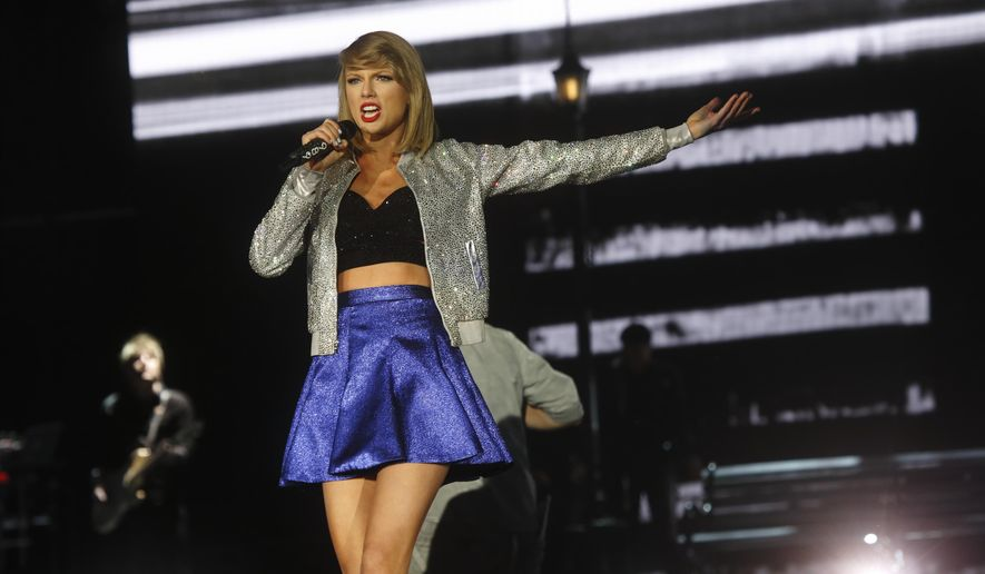 FILE - In this May 15, 2015 file photo, Taylor Swift performs at Rock in Rio USA at the MGM Resorts Festival Grounds in Las Vegas.  Apple's abrupt about-face on paying royalties for songs during a three-month free-trial period for its new music service was a symbolic victory for superstar Swift and other artists, and a shrewd business move by Apple, at a time when the streaming phenomenon is causing major changes in the music industry. Apple had already agreed to share revenue from the new Apple Music service once users start paying a $10-a-month subscription fee for the service, which it plans to launch June 30, 2015. (Photo by John Davisson/Invision/AP, File)