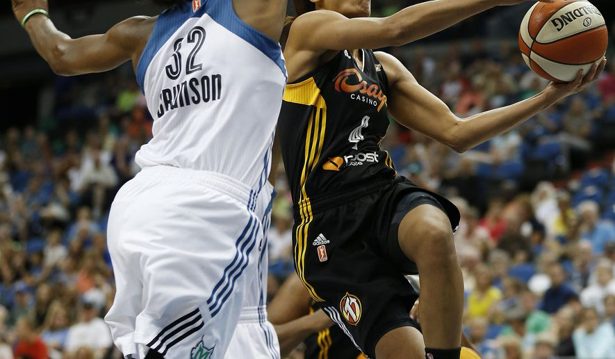 Tulsa Shock guard Skylar Diggins (4) jumps to the basket against Minnesota Lynx forward Rebekkah Brunson (32) during the first half of a WNBA basketball game, Sunday, June 21, 2015, in Minneapolis. (AP Photo/Stacy Bengs)