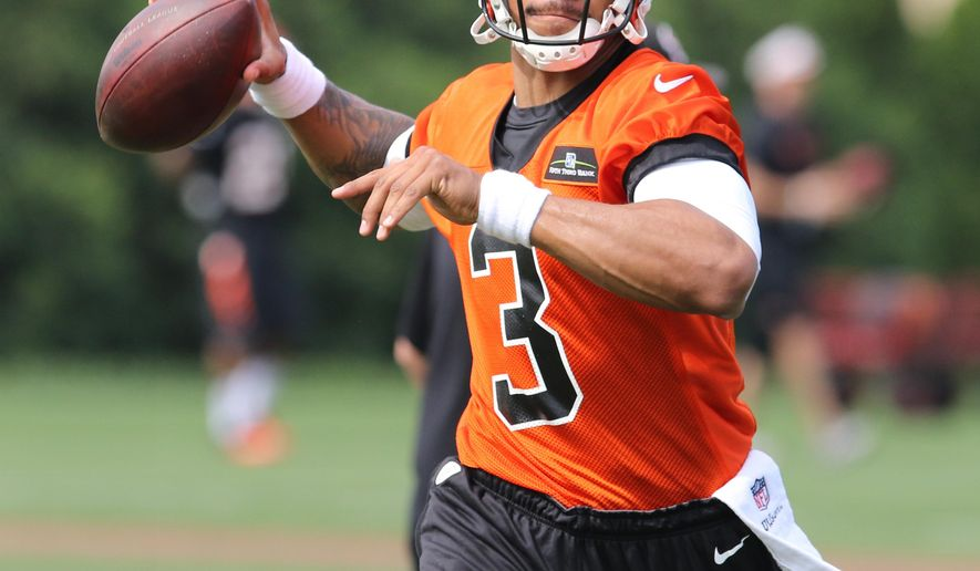 FILE - In this May 9, 2015, file photo, Cincinnati Bengals quarterback Terrelle Pryor throws during NFL football rookie minicamp in Cincinnati. The Cleveland Browns on Monday, June 22, 2015, have been awarded Pryor on waivers from Cincinnati and will give him a chance to make their roster as a wide receiver.(AP Photo/Gary Landers, File)