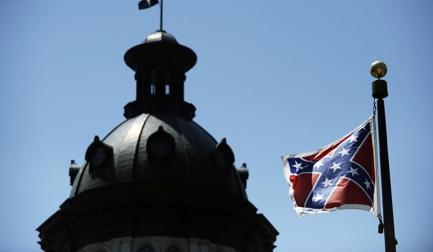 A Confederate flag flies near the South Carolina Statehouse in Columbia, South Carolina. (AP Photo/Rainier Ehrhardt)