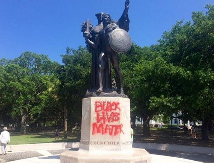 """Vandals spray-painted """"Black Lives Matter"""" and other racial messages on a memorial honoring fallen Confederate soldiers in Charleston, South Carolina. (Twitter/Philip Weiss)"""
