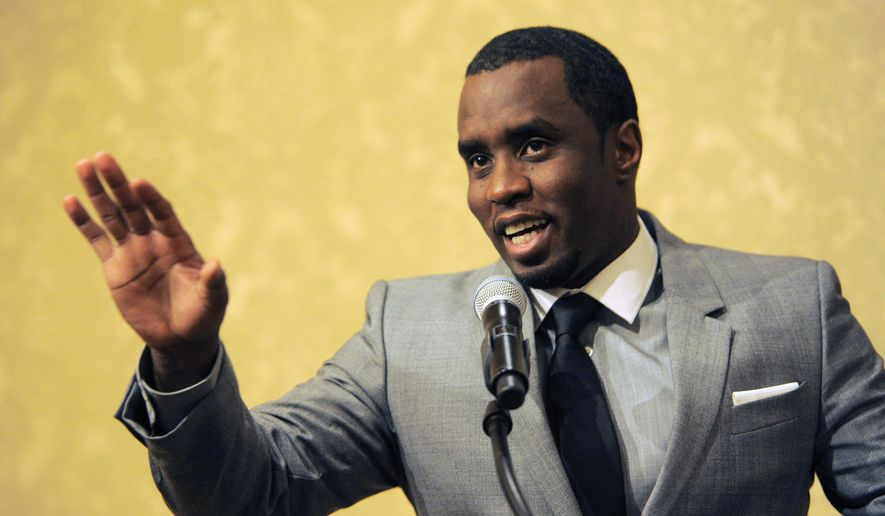 "Sean ""Diddy"" Combs of the new network Revolt TV addresses reporters at the Beverly Hilton Hotel in Beverly Hills, Calif., in this July 26, 2013, file photo. (Photo by Chris Pizzello/Invision/AP, File)"