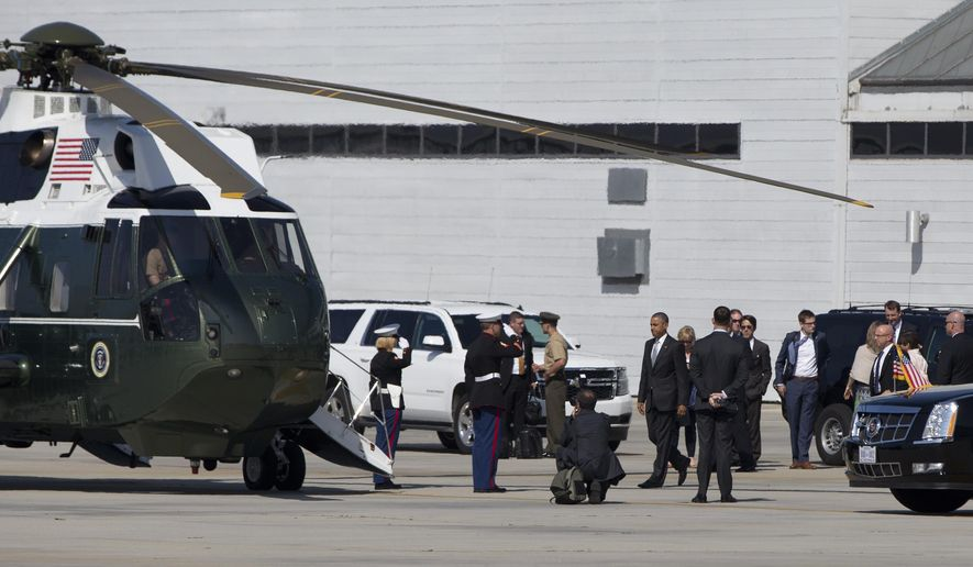 President Barack Obama walks to board Marine One Friday, June 19, 2015, at the Santa Monica, Calif, landing zone  en route to tape a podcast interview with comedian Marc Maron in Pasadena, Calif. (AP Photo/Carolyn Kaster)