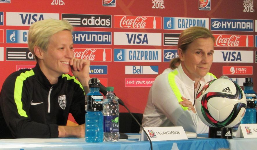 U.S. midfielder Megan  Rapinoe, left,  and coach Jill Ellis speak at a news conference on Sunday, June 21, 2015, in Edmonton, Alberta, Canada. The United States faces Colombia on Monday in the round of 16 at the Women's World Cup. (AP Photo/Anne M. Peterson).