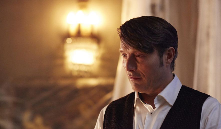"This photo provided by NBC shows, Mads Mikkelsen as Hannibal Lecter in the episode ""Contorno,"" during season 3 of the NBC television series, ""Hannibal.""  (Sophie Giraud/NBC via AP)"