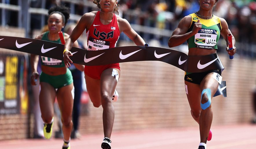 FILE - In this April 25, 2015, file photo, Natasha Morrison, right, of Jamaica, edges Kaylin Whitney, of the United States, at the finish line to win the USA vs. the World Women's 4x100-meter race at the Penn Relays athletics meet in Philadelphia. Whitney, the soon-to-be high school senior passed on a college career to turn pro early, signing a shoe deal on her 17th birthday in March. She hopes to make the final in the 100 and 200 this week at nationals in Eugene, Ore. Next summer, even bigger ambitions: Earn a spot for the Rio Olympics. (AP Photo/Rich Schultz, File)