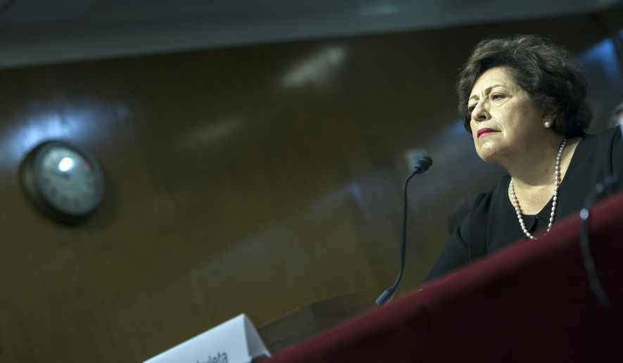 Katherine Archuleta, director, Office of Personnel Management, testifies before the Senate Appropriations subcommittee on Financial Services and General Government hearing to review IT spending and date security at the OPM in Washington, Tuesday, June 23, 2015. (AP Photo/Cliff Owen)