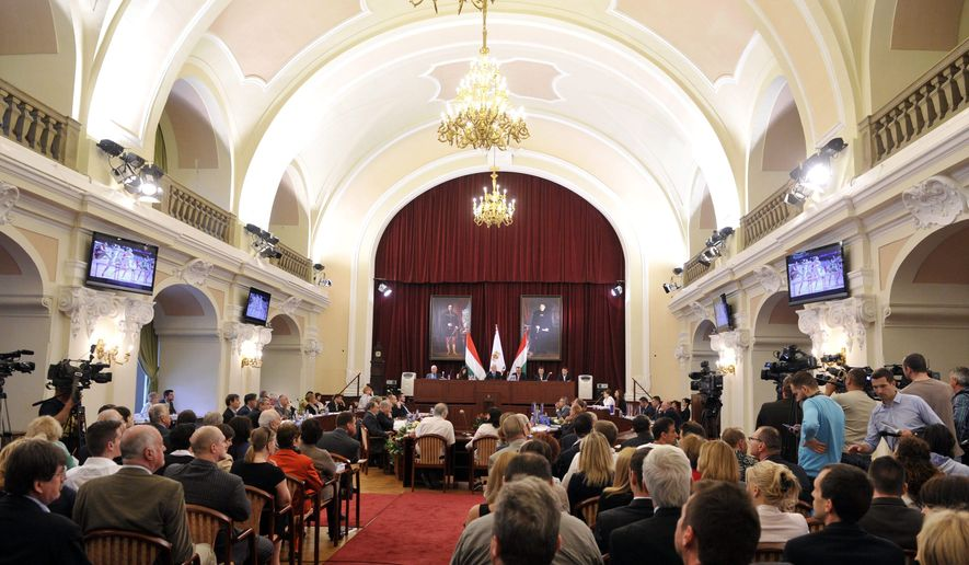 General meeting of the Metropolitan Municipality in Budapest, Hungary, Tuesday, June 23, 2015. The general meeting voted Budapest as the candidate city to host the Summer Olympics in 2024. (Attila Kovacs/MTI via AP)