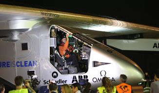 Pilot Andre Borschberg is seated in the cockpit of Solar Impulse 2 at Nagoya Airport in Toyoyama, near Nagoya, central Japan, Wednesday, June 24, 2015. A solar-powered plane carrying no fuel has postponed its departure from central Japan for Hawaii due to worse than expected weather conditions. (AP Photo/Koji Ueda) ** FILE **
