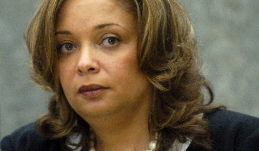 This May 13, 2008 photo shows Quinshaunta Golden, a former Illinois Department of Public Health aide in Chicago. Golden pleaded guilty in April 2014 to bribery, theft and obstruction of justice in the kickback scheme and has been sentenced to eight years in prison Tuesday, June 23, 2015, for her part in the scheme that defrauded the state of millions of dollars. (Keith Hale/Sun-Times Media via AP)