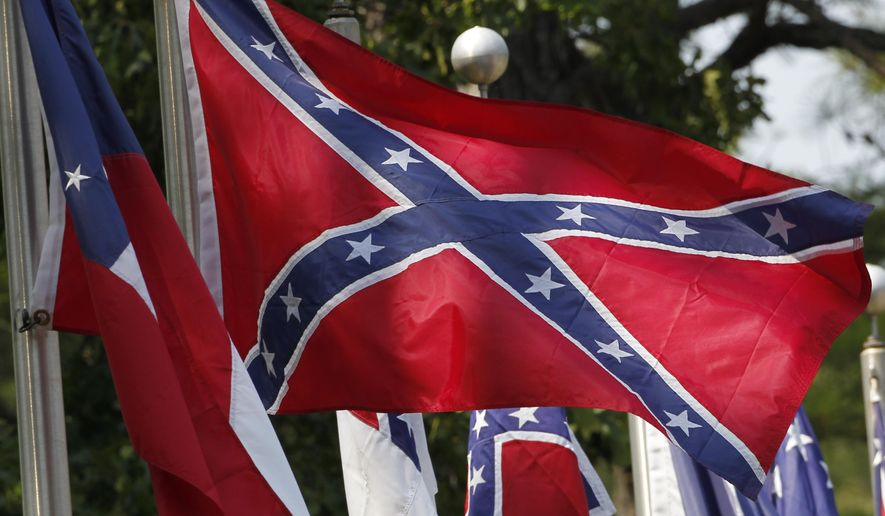 FILE - In this July 19, 2011 file photo, Confederate battle flags fly outside the museum at the Confederate Memorial Park in Mountain Creek, Ala., Tuesday, July 19, 2011. Major retailers are halting sales of the Confederate flag after the June 17, 2015 shooting deaths of nine black church members in South Carolina. (AP Photo/Dave Martin, File)