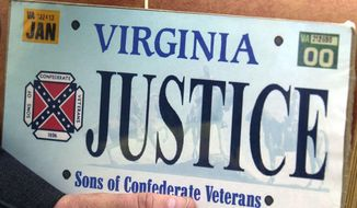 A sample of the Sons of Confederate Veterans specialty Virginia state license plate in Richmond, Va., is seen here on May 2, 2002. (Mark Gormus/Richmond Times Dispatch via Associated Press) **FILE**