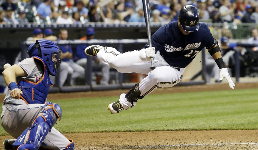 Milwaukee Brewers' Carlos Gomez is hit by a pitch during the fifth inning of a baseball game against the New York Mets Tuesday, June 23, 2015, in Milwaukee. (AP Photo/Morry Gash)