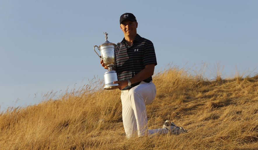 Jordan Spieth poses with the trophy after winning the U.S. Open golf tournament at Chambers Bay on Sunday, June 21, 2015 in University Place, Wash. (AP Photo/Ted S. Warren)
