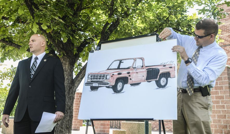 Members of a task force displays an artist's rendering of a pickup truck that authorities believe to be a vehicle of interest in the June 3 shootings in Loveland, Colo., before a news conference at the Loveland Police Department, Tuesday, June 23, 2015 in Loveland, Colo. Investigators are looking for the vehicle believed to be connected with one of three apparently random roadside shootings in northern Colorado, along with a previously unreported attempted shooting. (Morgan Spiehs/The Coloradoan via AP) MANDATORY CREDIT