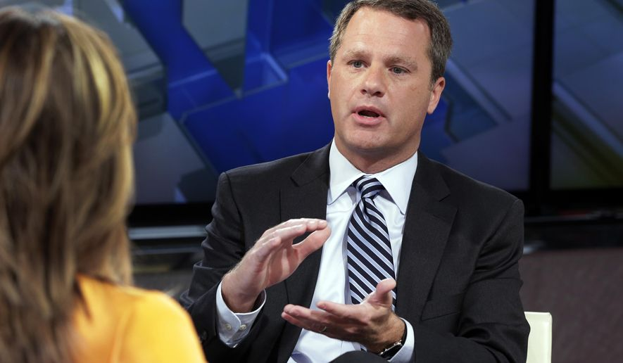 "Wal-Mart President & CEO Doug McMillon is interviewed by Maria Bartiromo during her ""Mornings with Maria Bartiromo"" program on the Fox Business Network, in New York, Tuesday, June 23, 2015. Wal-Mart says it's removing items featuring the Confederate flag from shelves and its website. (AP Photo/Richard Drew)"