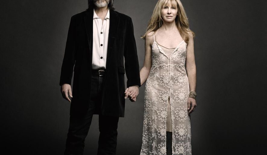 This CD cover image released by Red House shows the self-titled album by Larry Campbell and Teresa Williams. (Red House via AP)