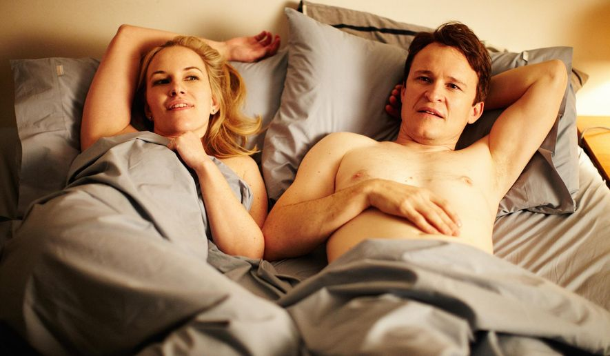 "This photo provided by courtesy of Magnolia Pictures shows Kate Mulvany, left, and Damon Herriman in the film, ""The Little Death,"" a Magnolia Pictures release. (Magnolia Pictures via AP)"