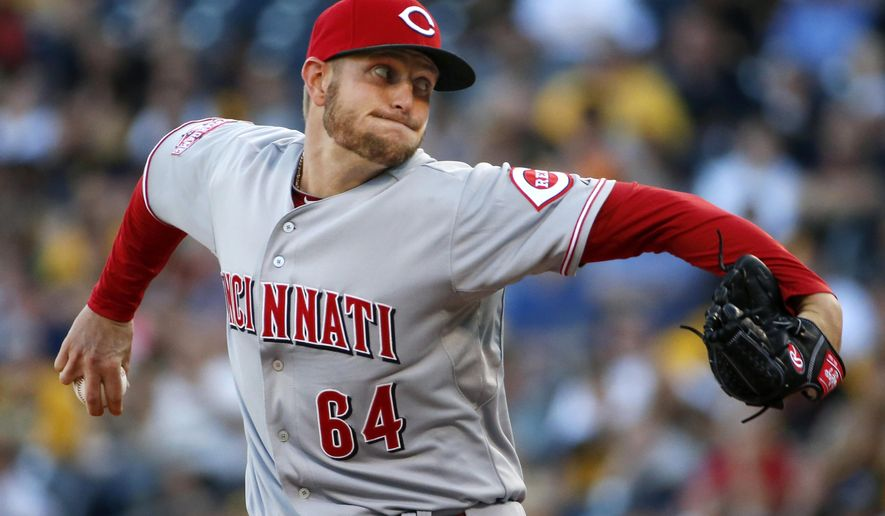 Cincinnati Reds starting pitcher Josh Smith winds up delivers during his first major league start, in the opening inning of a baseball game against the Pittsburgh Pirates in Pittsburgh, Tuesday, June 23, 2015. (AP Photo/Gene J. Puskar)