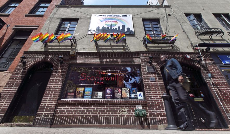 FILE - This May 29, 2014 file photo shows The Stonewall Inn, in New York's Greenwich Village. New York City's landmarks commission voted Tuesday, June 23, 2013, to grant official status to the bar where resistance to a police raid sparked the modern gay rights movement. (AP Photo/Richard Drew, File)