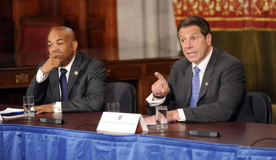 New York Gov. Andrew Cuomo, right, speaks during a news conference along with Assembly Speaker Carl Heastie, D-Bronx, Tuesday, June 23, 2015, at the Capitol in Albany, N.Y. Cuomo and legislative leaders have reached agreements on extending rent controls for more than two million tenants and for property tax rebates for homeowners upstate and on Long Island. (AP Photo/Tim Roske)