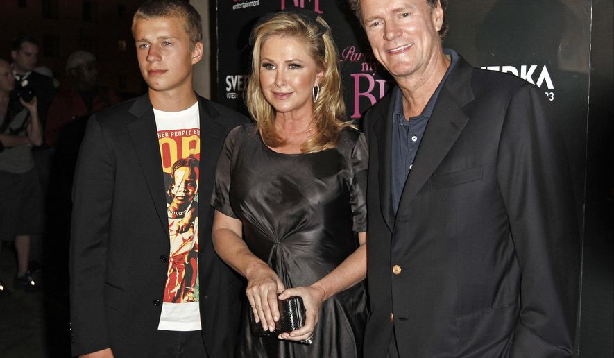 "FILE - In this Sept. 30, 2008, file photo, Conrad Hilton, left, Kathy Hilton, center, and Rick Hilton arrive at the launch party of new MTV series ""Paris Hilton's My New BFF"" in Los Angeles. Police say Conrad Hilton, the younger brother of Paris Hilton, has been arrested at his ex-girlfriend's Hollywood Hills home on suspicion of violating a restraining order. Officer Liliana Preciado says the woman called police Monday, June 22, 2015 afternoon to say Conrad Hilton was trying to gain access to her property. (AP Photo/Matt Sayles, File)"