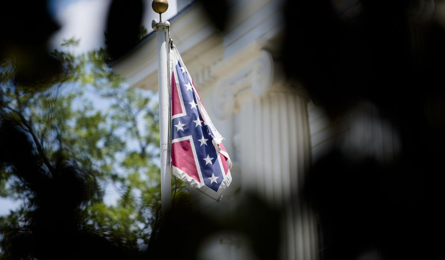 A Confederate flag flies on the grounds of the Alabama Capitol building in Montgomery, Ala., Monday, June 22, 2015. (Albert Cesare/The Montgomery Advertiser via AP)  NO SALES; MANDATORY CREDIT
