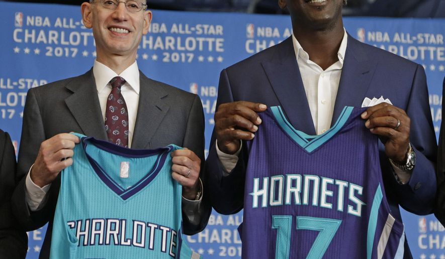 NBA Commissioner Adam Silver, left, and Charlotte Hornets owner Michael Jordan, right, pose for a photo during a news conference, Tuesday, June 23, 2015, to announce Charlotte, N.C., as the site of the 2017 NBA All-Star basketball game. (AP Photo/Chuck Burton)