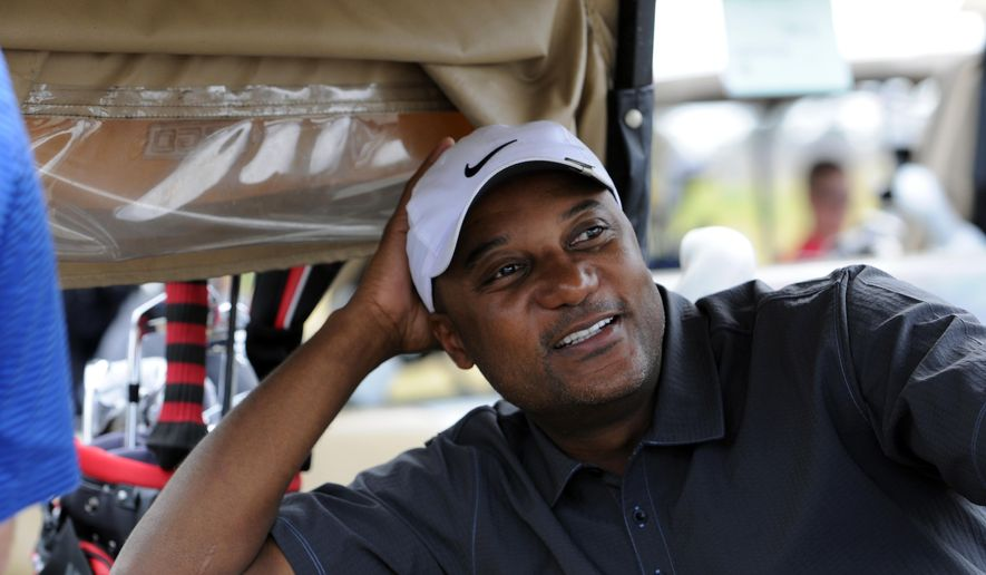 FILE - In this Nov. 11, 2011, file photo, former professional baseball player Darryl Hamilton sits in a golf cart at the Urban Youth Academy Celebrity Golf Classic, hosted by Ron Washington and Chad Gaudin, at English Turn Golf Course in New Orleans. Authorities say Hamilton was killed Sunday, June 21, 2015, in a murder-suicide in the Houston suburb of Pearland, Texas. Pearland police say an initial investigation has determined Hamilton had been shot several times and that a woman in the home died of a self-inflicted gunshot wound. The woman was identified as Monica Jordan. (Cheryl Gerber/AP Images for MLB, via AP, File)