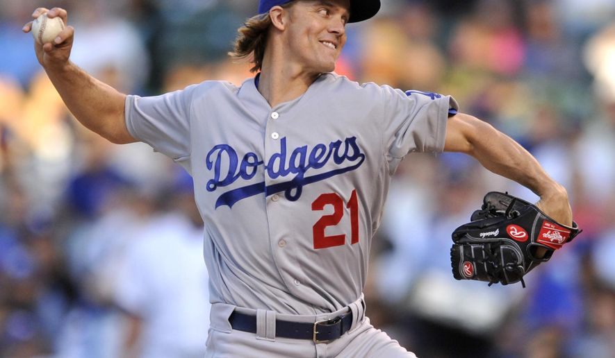 Los Angeles Dodgers starter Zack Greinke delivers a pitch during the first inning of a baseball game against the Chicago Cubs on Tuesday, June 23, 2015 in Chicago. (AP Photo/Paul Beaty)