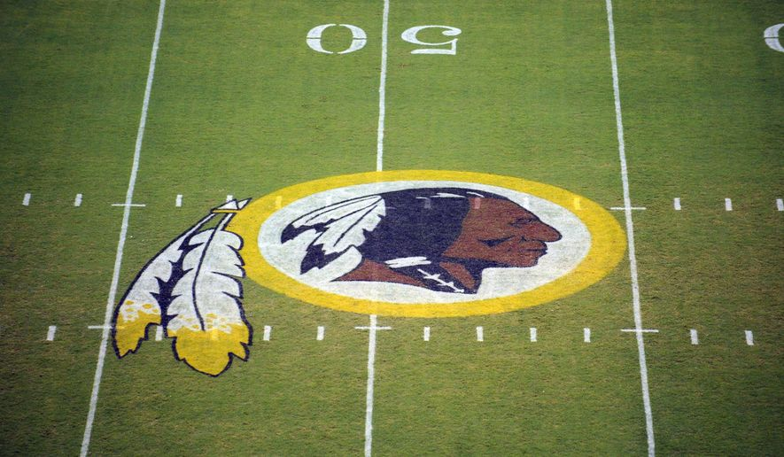 In this Aug. 28, 2009, file photo, the Washington Redskins logo is seen on the field before the start of a preseason NFL football game in Landover, Md. (AP Photo/Nick Wass, File)