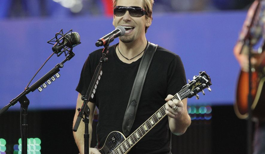 FILE - In this Nov. 24, 2011 file photo, Nickelback lead vocalist Chad Kroeger and his band perform during halftime of an NFL football game between the Detroit Lions and the Green Bay Packers in Detroit. Nickelback is canceling its summer tour as lead singer Chad Kroger has been diagnosed with an operable cyst on his voice box. The band posted a statement and a video on its website Tuesday, June 23, 2015, about canceling the rest of its 2015 No Fixed Address North American Tour. (AP Photo/Carlos Osorio, File)