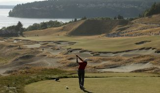 FILE - In this June 20, 2015, file photo, Jordan Spieth hits from the 14th tee during the third round of the U.S. Open golf tournament at Chambers Bay in University Place, Wash. The course that was built for a U.S. Open needs to start over. Chambers Bay deserves another chance to host the U.S. Open thanks to Jordan Spieth, who did more to put the course on the map than anything Robert Trent Jones Jr. did. (AP Photo/Charlie Riedel, File0