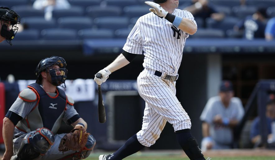 New York Yankees Stephen Drew hits a ninth-inning solo home run off Detroit Tigers relief pitcher Joakim Soria in the Yankees 12-4 loss to the Tigers in a baseball game at Yankee Stadium in New York, Sunday, June 21, 2015. It was Drew's second home run of the game.  (AP Photo/Kathy Willens)